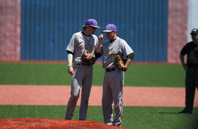 Chase Watt (left) talks with starter Kyle Singer on the mound in Avila's loss on Saturday to Benedictine. (Photo Credit: Josh