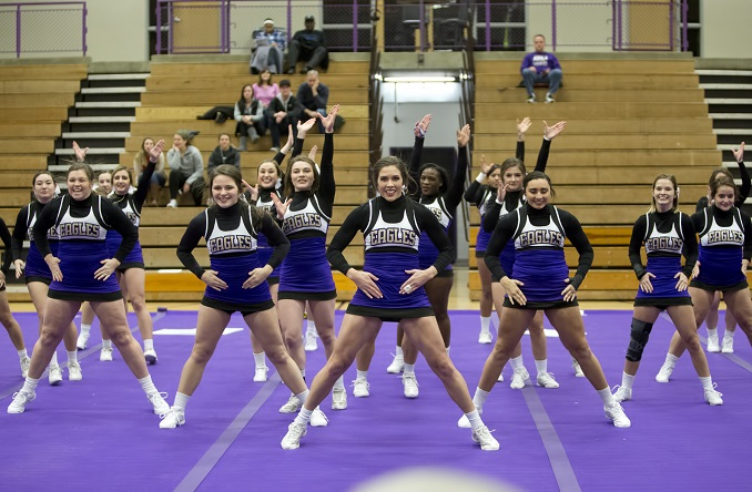 The Avila Cheer Team performs at halftime of the women's basketball game Wednesday night in Mabee Fieldhouse.