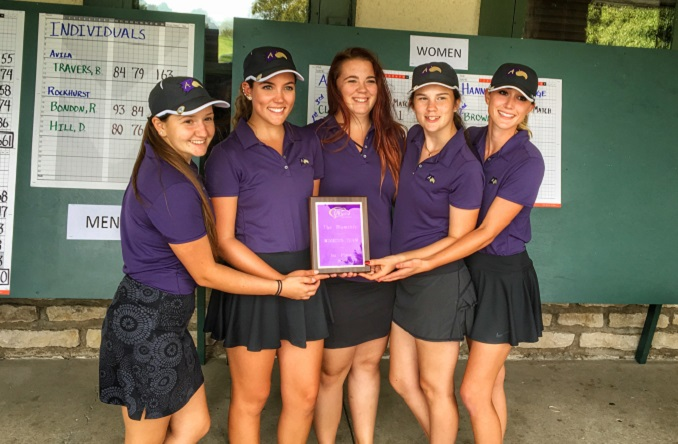 Abby Clark (second from left) and the Eagles pose with their first place plaque after winning The Dominic.