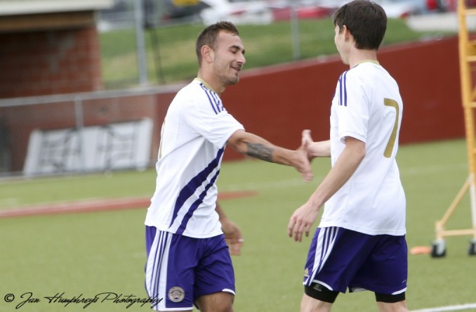 Cody Jeffrey (left) celebrates with Brandon Brewster after scoring a goal Wednesday against No. 6 Baker.