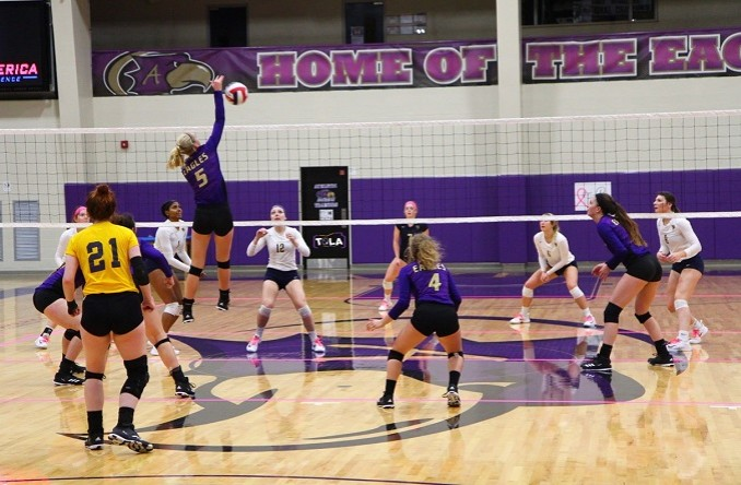 Laurel Dehn (5) skies for a kill in the fifth set of Avila's win over WPU Thursday. (Photo Credit: Talal Alaseeri)