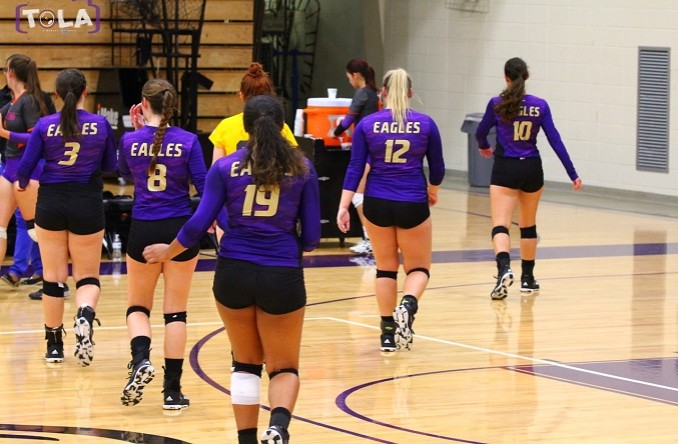The Eagles walk off the court during a timeout in the 2nd set against (RV) MVC. (Photo Credit: Talal Alaseeri)