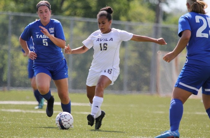 Darian Malone (middle) netted her first career goal Tuesday at Evangel. (Photo Credit: Talal Alaseeri)