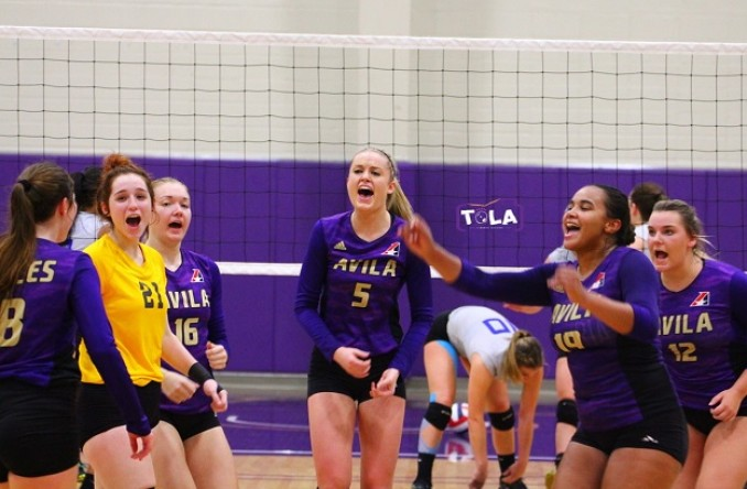 The team celebrated after a big point in the deciding 4th set against Culver Friday. (Photo Credit: Talal Alaseeri)